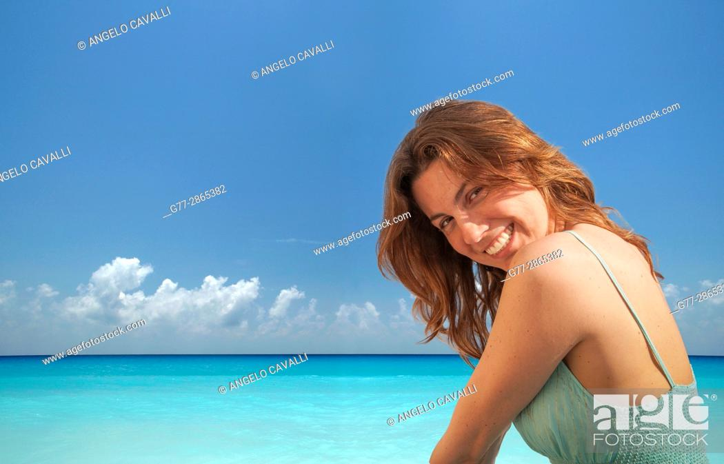 Stock Photo: Portrait of a young woman on the beach of Miami Beach, Florida, Usa.
