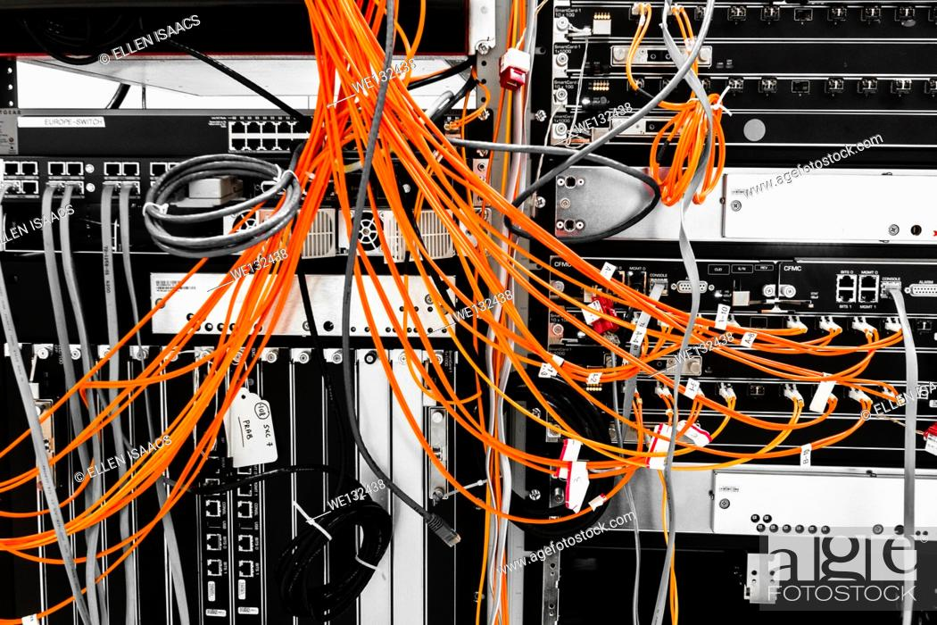 Stock Photo: Fiber cables plugged into a high end router machine at a computer data center.
