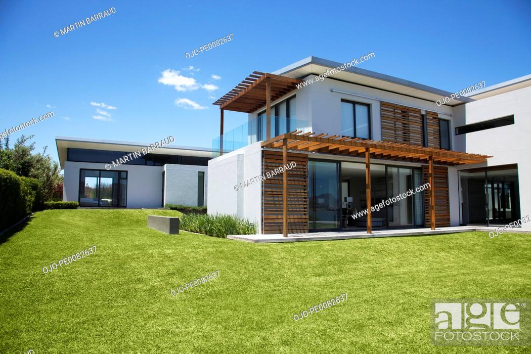 Stock Photo: Modern house and yard.