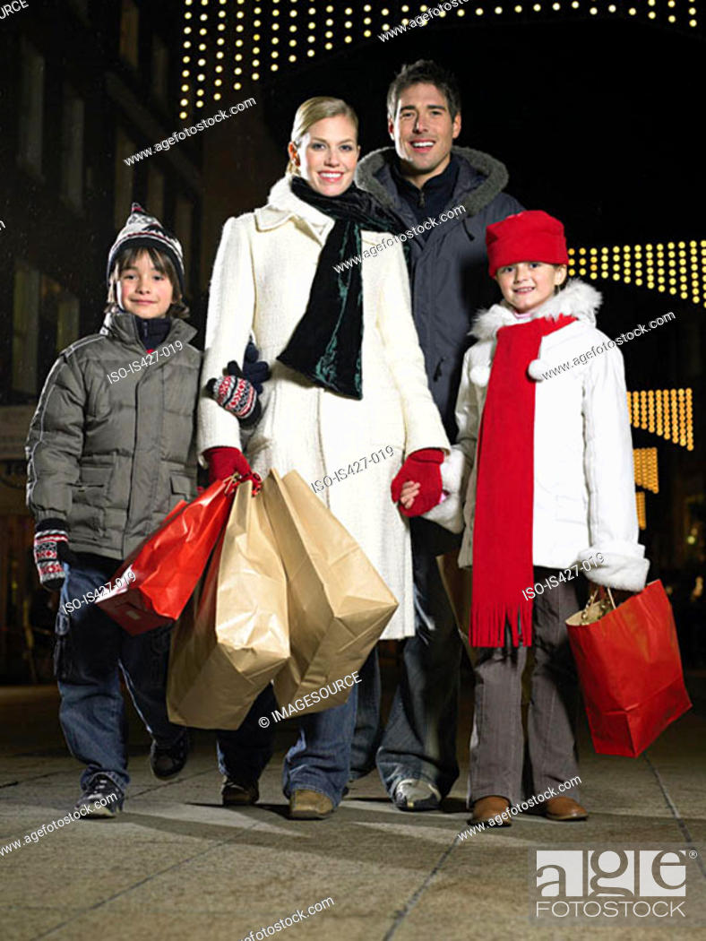 Stock Photo: Family out christmas shopping.