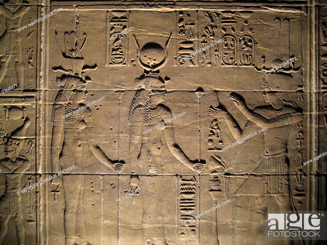 Stock Photo: Relief depicting a pharaoh making offerings to the goddesses Isis and Hathor, Philae, Egypt. The construction of the temple dedicated to the Ancient Egyptian.