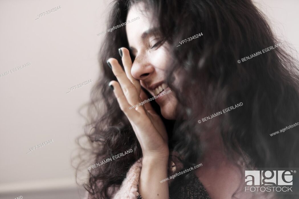 Stock Photo: young woman rubbing her eyes at home.