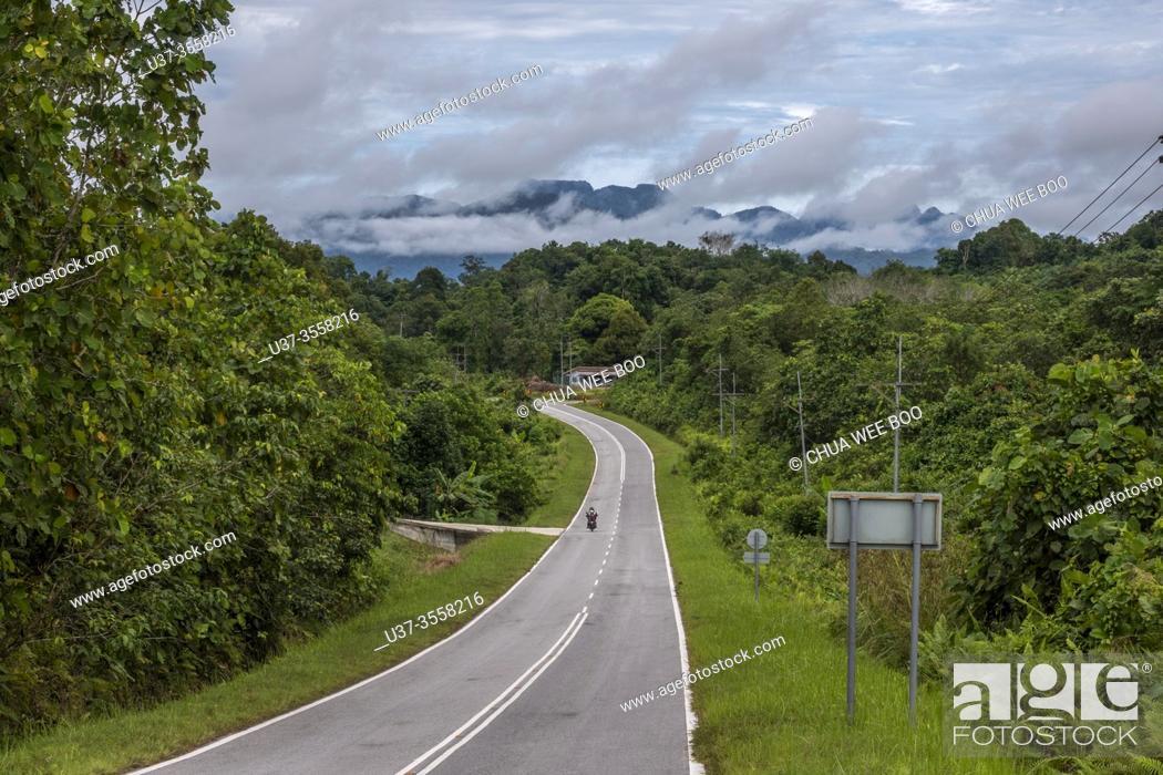 Stock Photo: The road to Tebedu town, Sartawak, Malaysia.