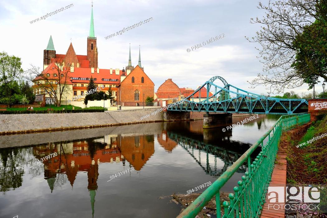 Stock Photo: Church of Sainte Cross, Saint John Baptist and Oder river in Wroclaw, Silesia, Poland.