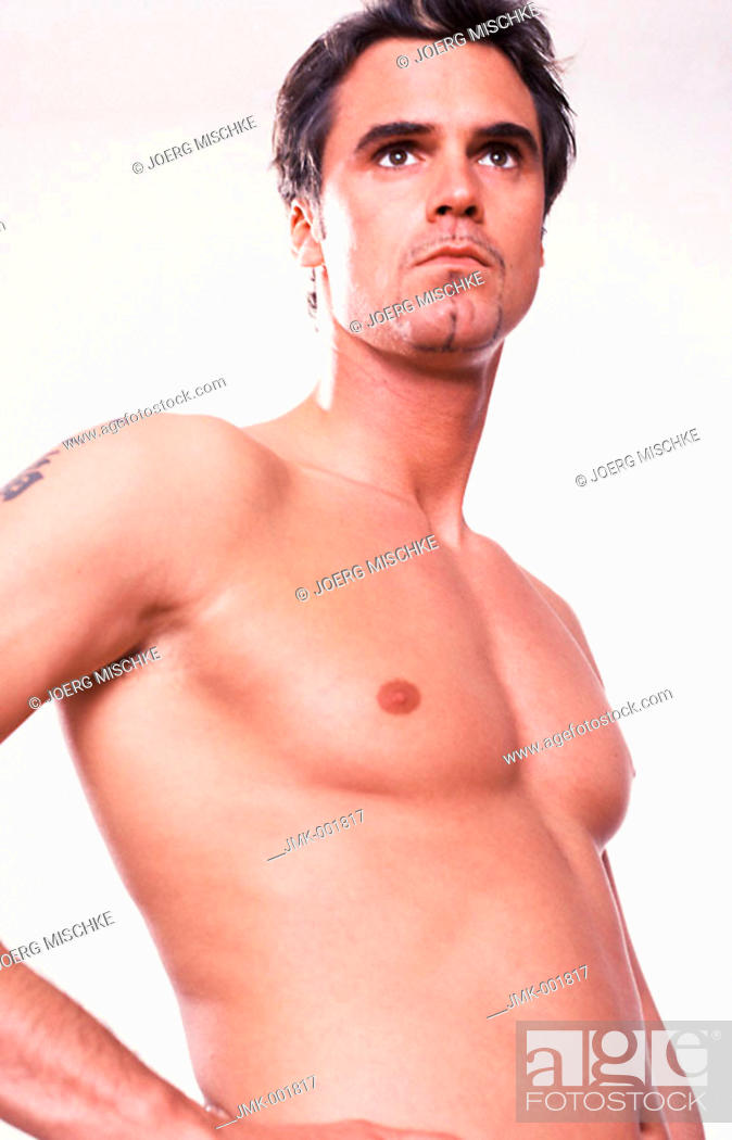 Stock Photo: Portrait of a young man, 20-25 25-30 30-35 years old, dark-haired, masculine, athletic and beautiful, stripped to the waist.