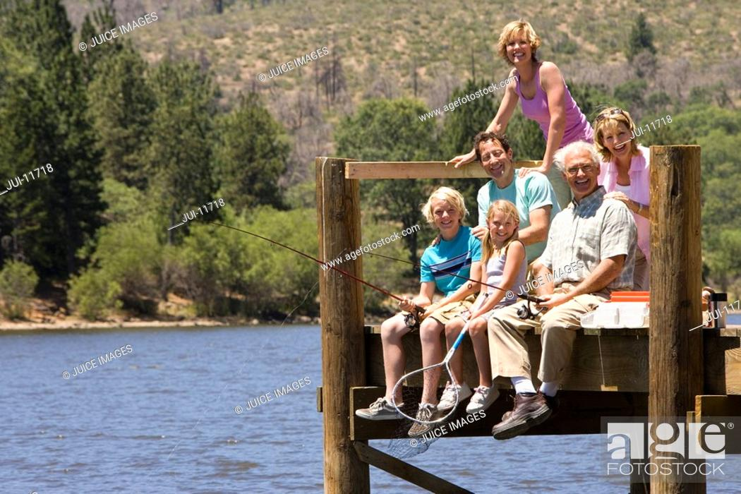Stock Photo: Family of three generations fishing on jetty, smiling, portrait.