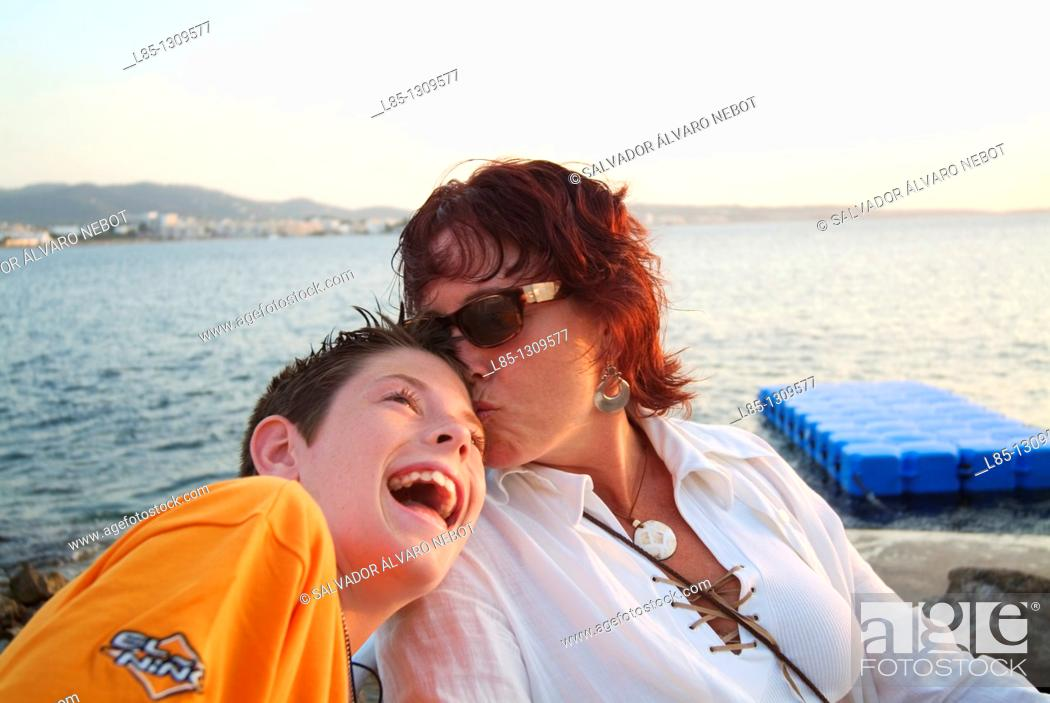 Stock Photo: Mother and son at sunset, Ibiza, Balearic Islands, Spain.