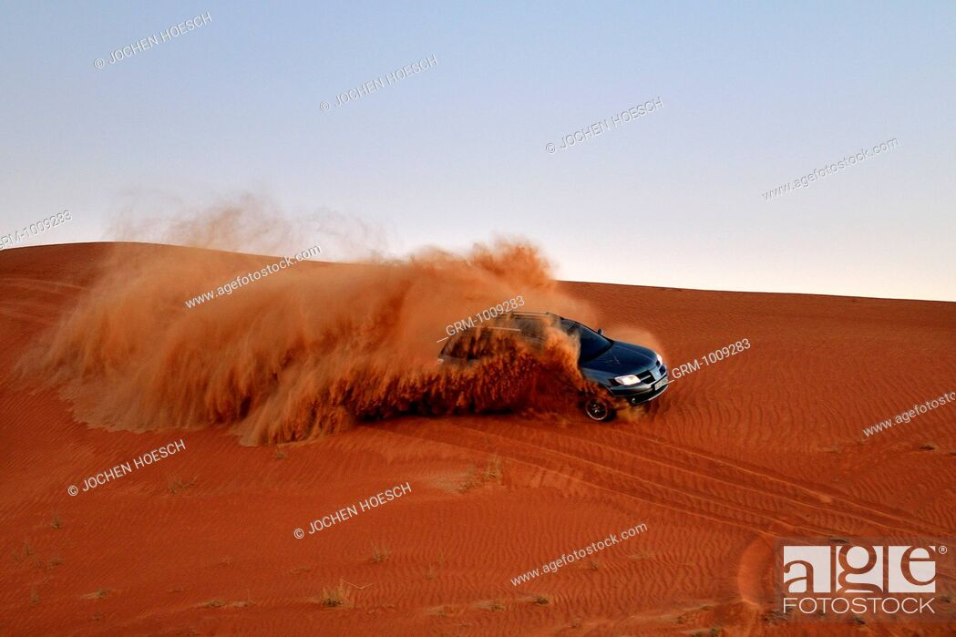 Stock Photo: Dune bashing with 4x4 car in the desert near Al Ain, United Arab Emirates.