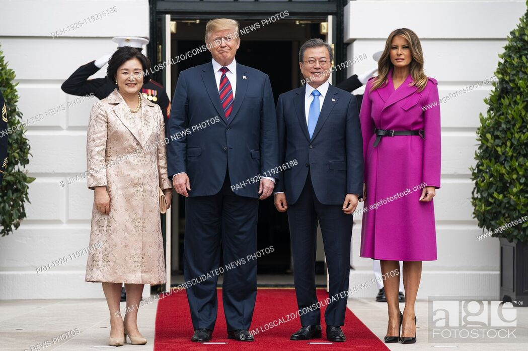 Stock Photo: US President Donald J. Trump (C-L) and First Lady Melania Trump (R) welcome Korean President Moon Jae-in (C-R) and Mrs. Kim Jung-sook (L) to the South Portico.