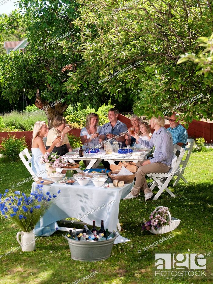 Stock Photo: Family having party in garden.
