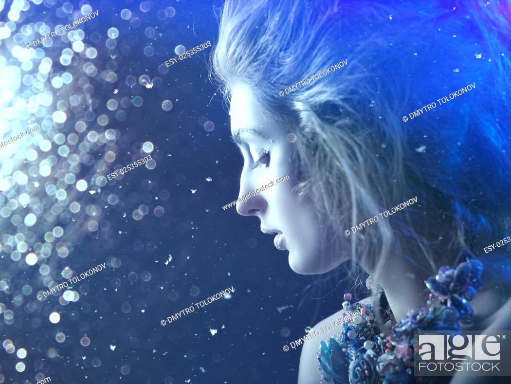 Stock Photo: Winter beauty. Fantastic seasonal female portrait with abstract background.