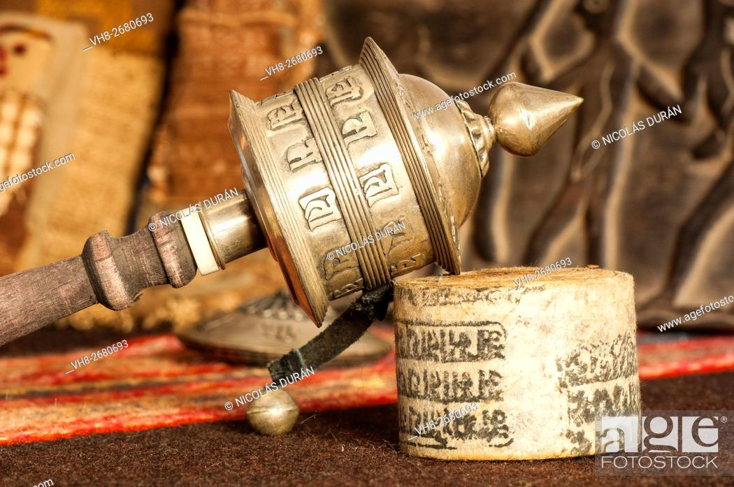 Stock Photo: Tibetan hand prayer wheel with rolled-up paper bearing inscribed mantras. Katmandu. Nepal. Asia.
