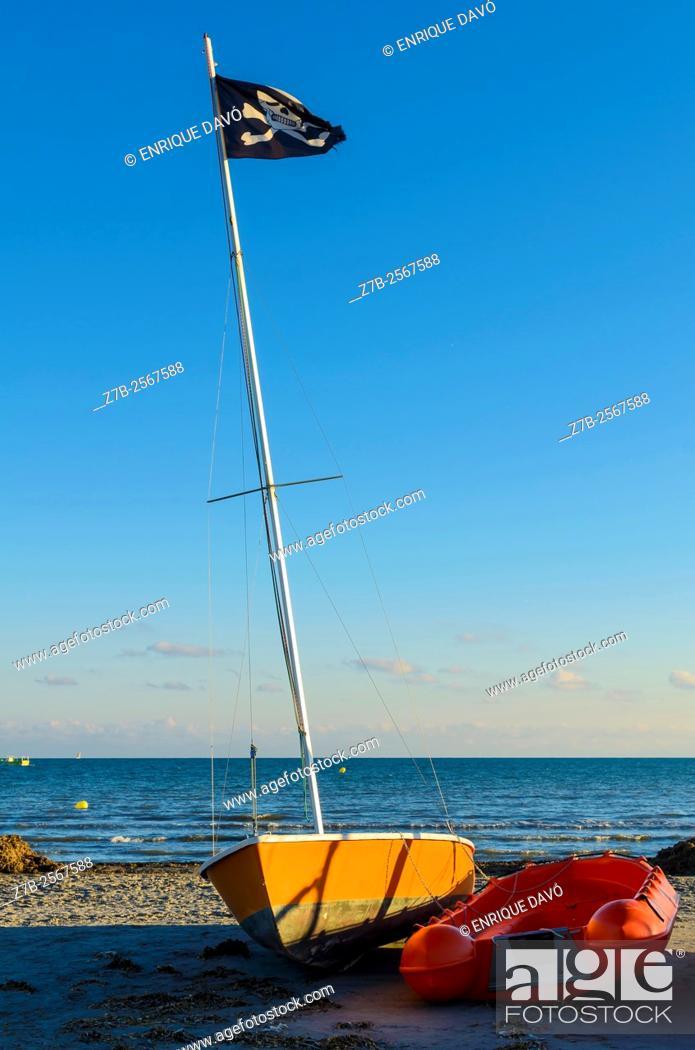 Stock Photo: A black flag view in Tamarit beach, Alicante, Spain.
