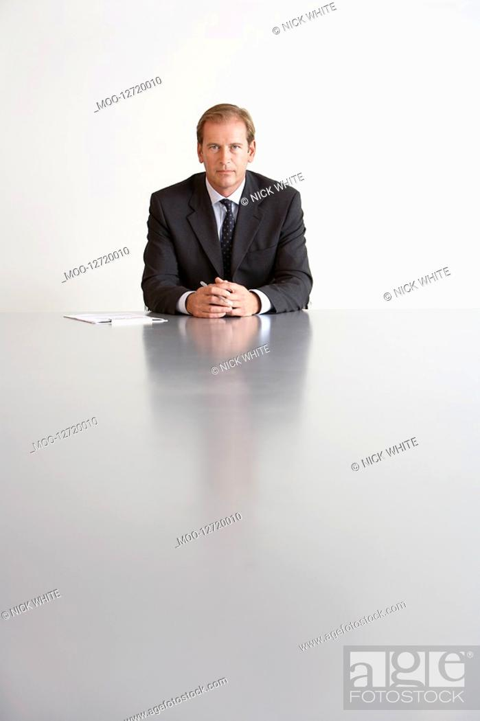Stock Photo: Businessman Sitting in Conference Room.