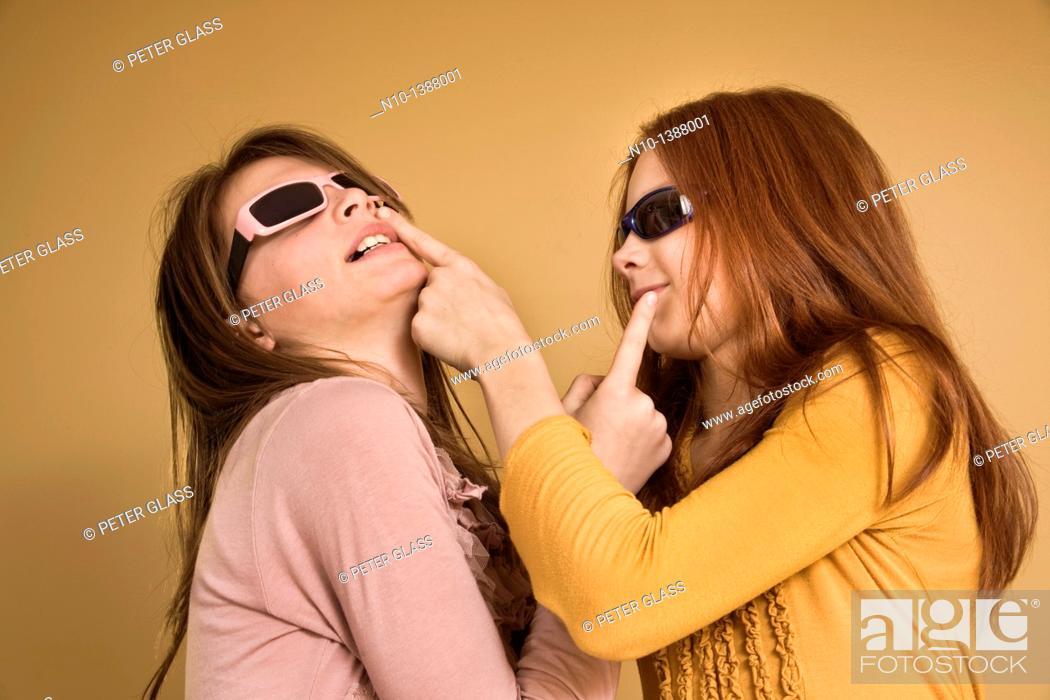 Stock Photo: Preteen girls wearing sunglasses.