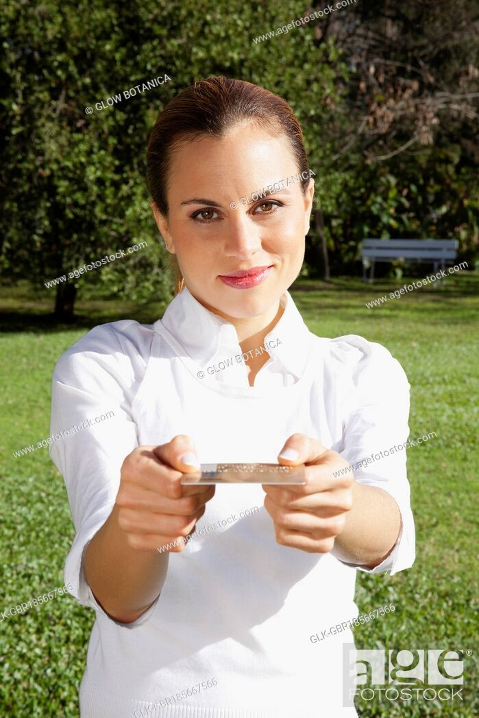 Stock Photo: Portrait of a businesswoman showing a credit card.