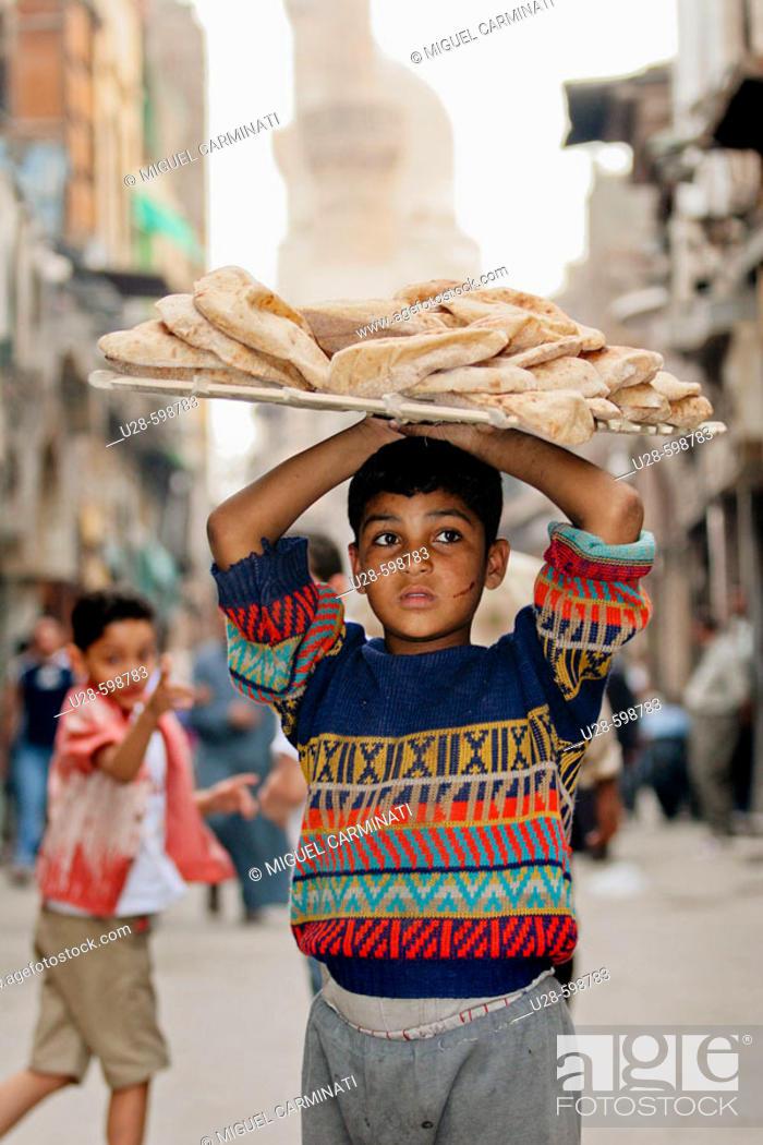 Stock Photo: worker child on egypcian market.