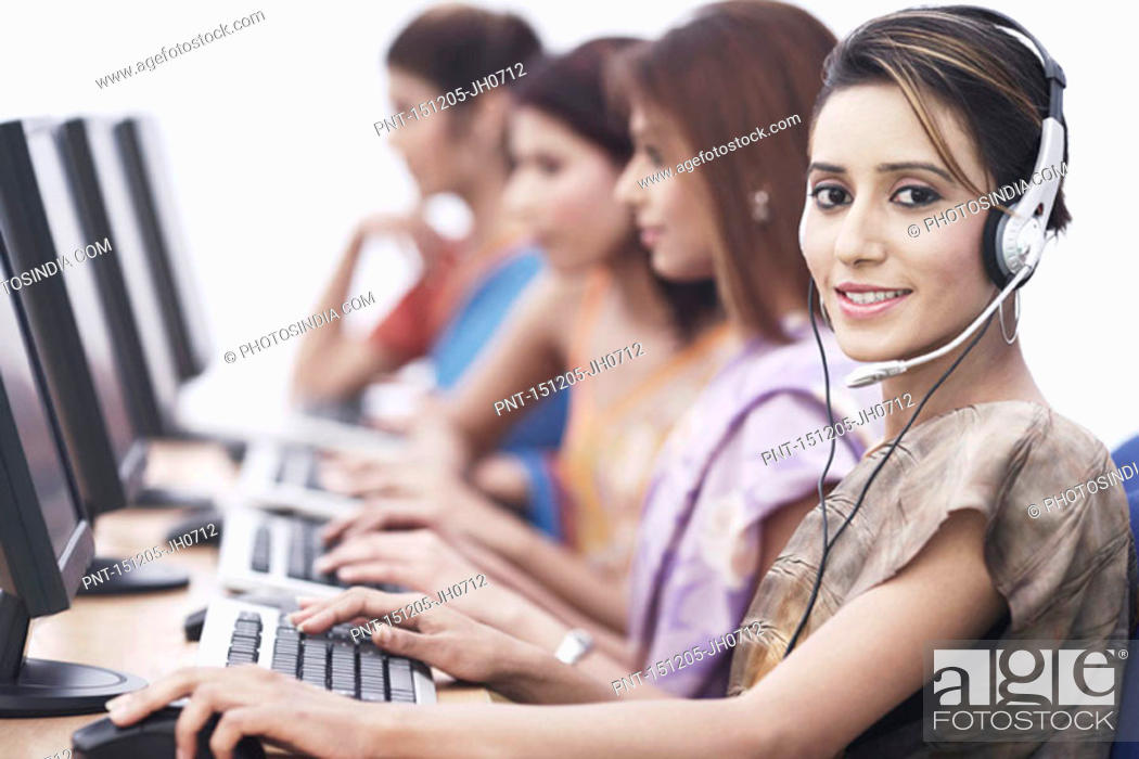 Stock Photo: Portrait of a businesswoman sitting in front of a computer.