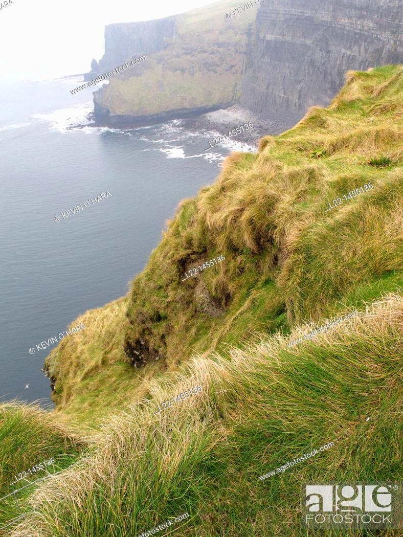 Stock Photo: The Cliffs of Moher are located in the parish of Liscannor at the south-western edge of the Burren area near Doolin. The cliffs rise 120 meters 394 ft above the.
