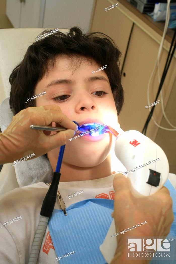 Stock Photo: CHILD RECEIVING DENTAL CARE.