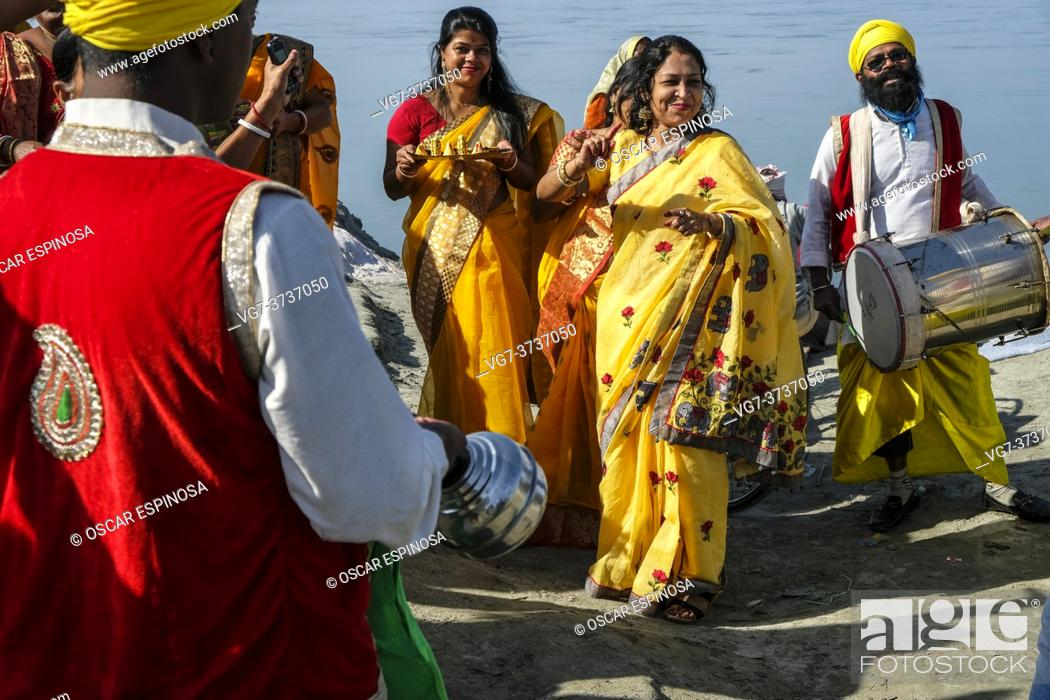 Stock Photo: Dibrugarh, India - November 2020: A group of people making offerings, singing and dancing before celebrating a wedding on November 25, 2020 in Dibrugarh, Assam.