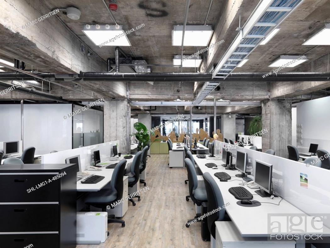 Stock Photo: Modern industrial office with rows of computers.