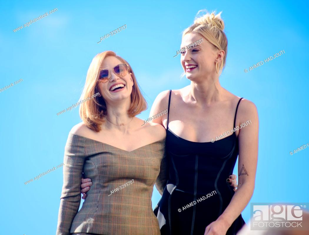 "Stock Photo: PARIS, FRANCE - April 26 : Actress Jessica Chastain and Sophie Turner attend the """"X-Men Dark Phoenix"""" Photocall At Cafe De L'Homme on April 26, 2019 in Paris."