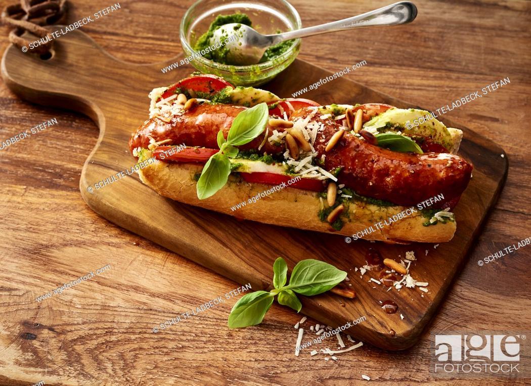 Stock Photo: Italian-style hot dog with basil pesto.