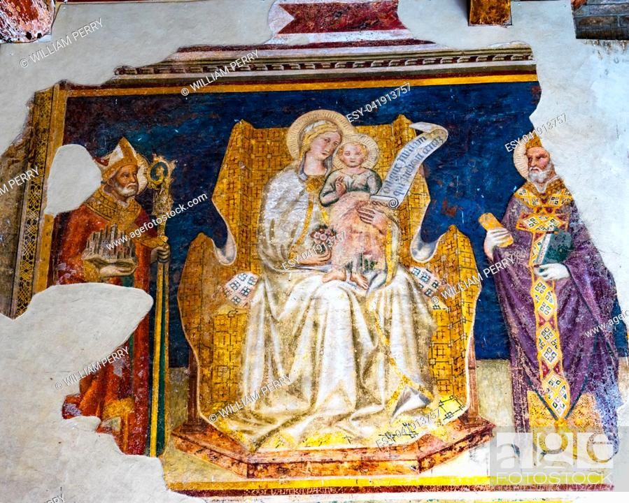 Stock Photo: Madonna and Child Between Saints Gregory and Gimignano Fresco by Taddeo di Bartolo Outside San Gimignano Italy Fresco done in the early 1500s.