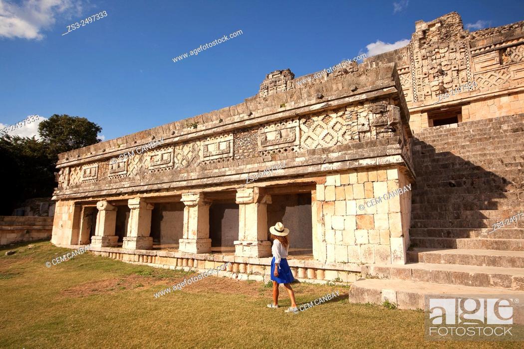 Stock Photo: Tourist at the Quadrangle Of The Nuns in Uxmal Ruins, Uxmal, Yucatan Province, Mexico, Central America.