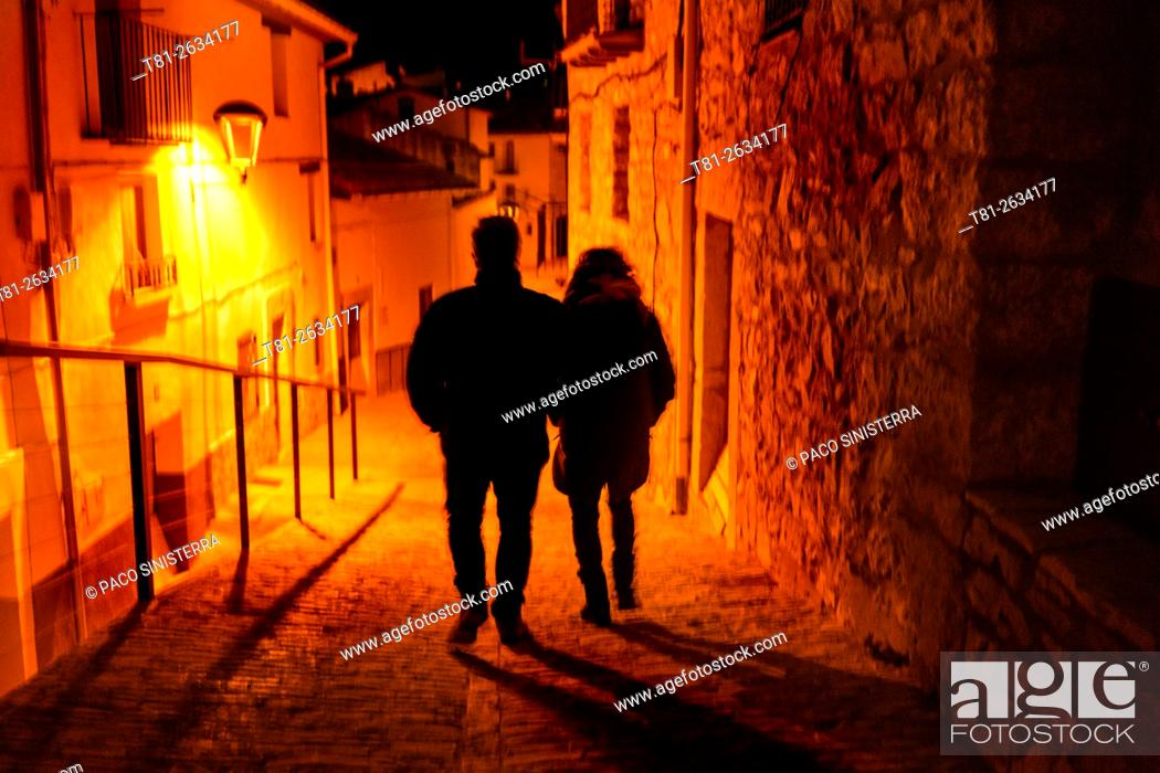 Stock Photo: Couple walking in Morella, Castellon, Spain.
