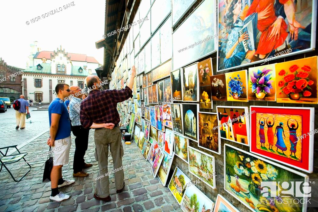 Stock Photo: Painter showing his paints at the city centre of Krakow, Poland.