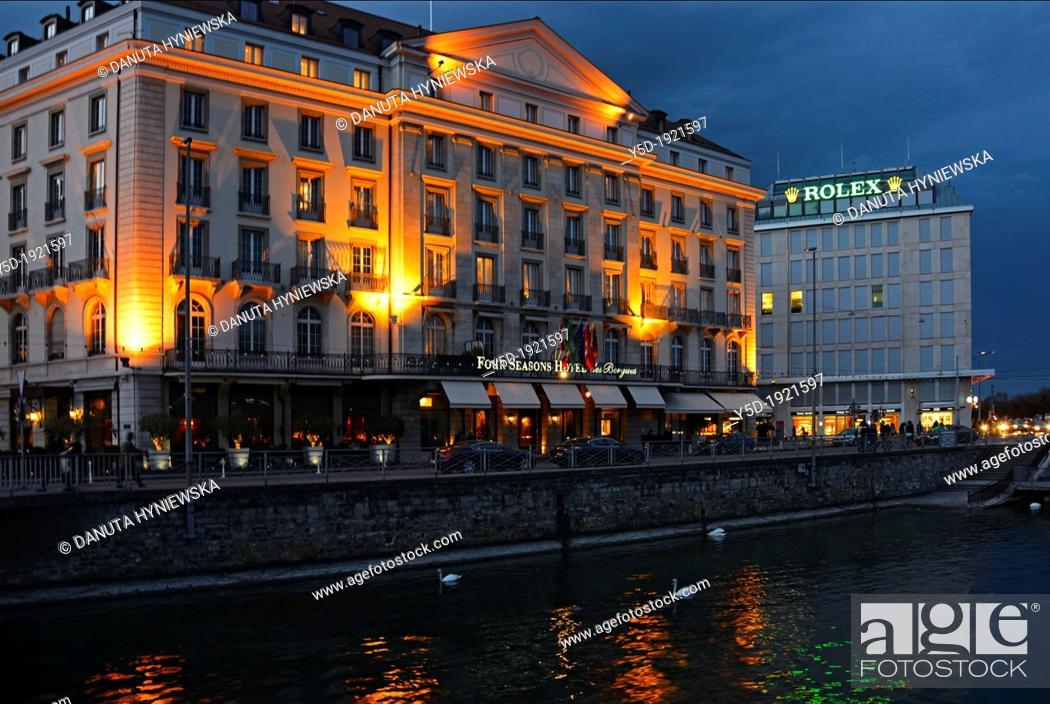 Stock Photo: Four Seasons Hotel des Bergues , Rhone river, downtown of Geneva at dusk, Switzerland.