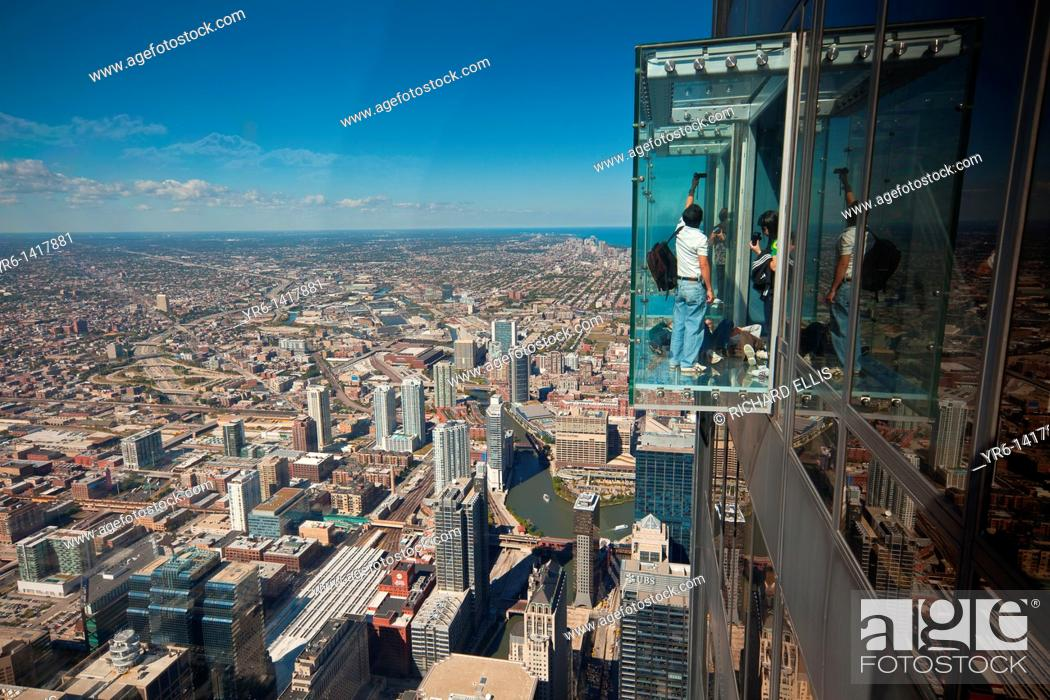 Tourists in the all glass balcony