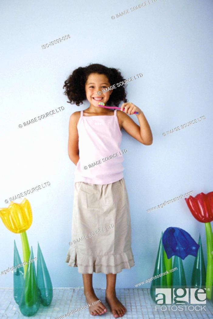 Stock Photo: Girl brushing teeth.