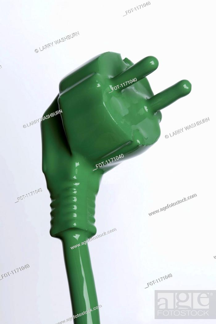 Stock Photo: A plug and cable painted green.