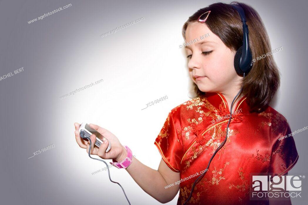 Stock Photo: Girl listening to music.