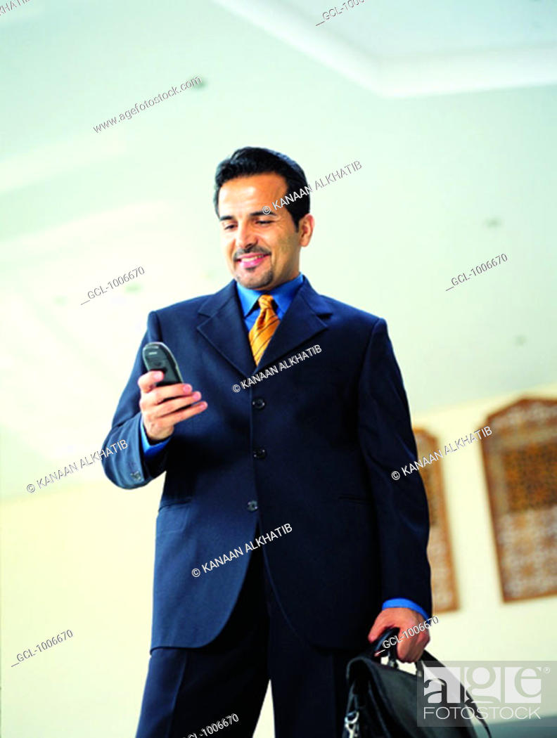 Stock Photo: Arab businessman using mobile phone.