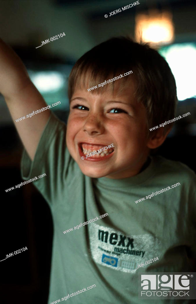 Stock Photo: A little boy, 5-10 years old, standing and making a grimace.
