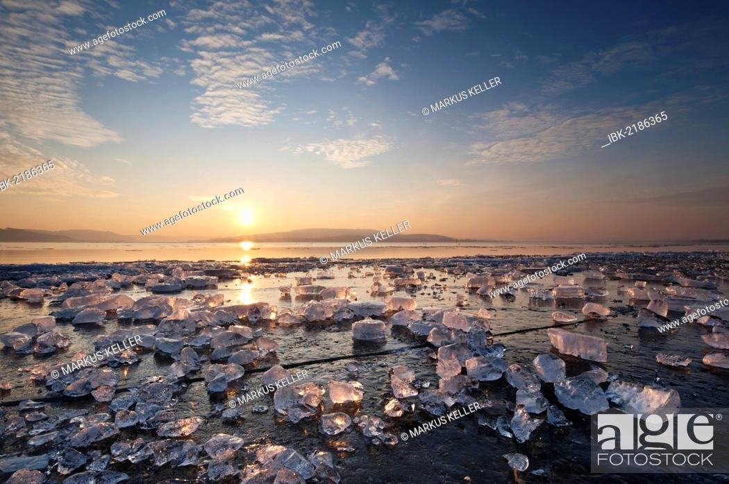 Stock Photo: Chunks of ice lying on icy surface on the shore of Reichenau Island at sunset, Baden-Wuerttemberg, Germany, Europe.