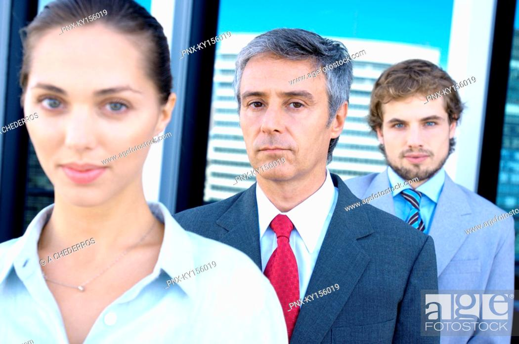 Stock Photo: Business people standing in row, portrait.