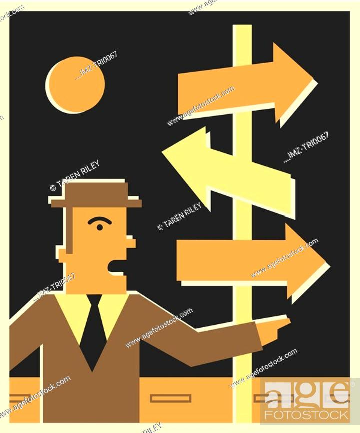 Stock Photo: Businessman standing in front of directional arrows.