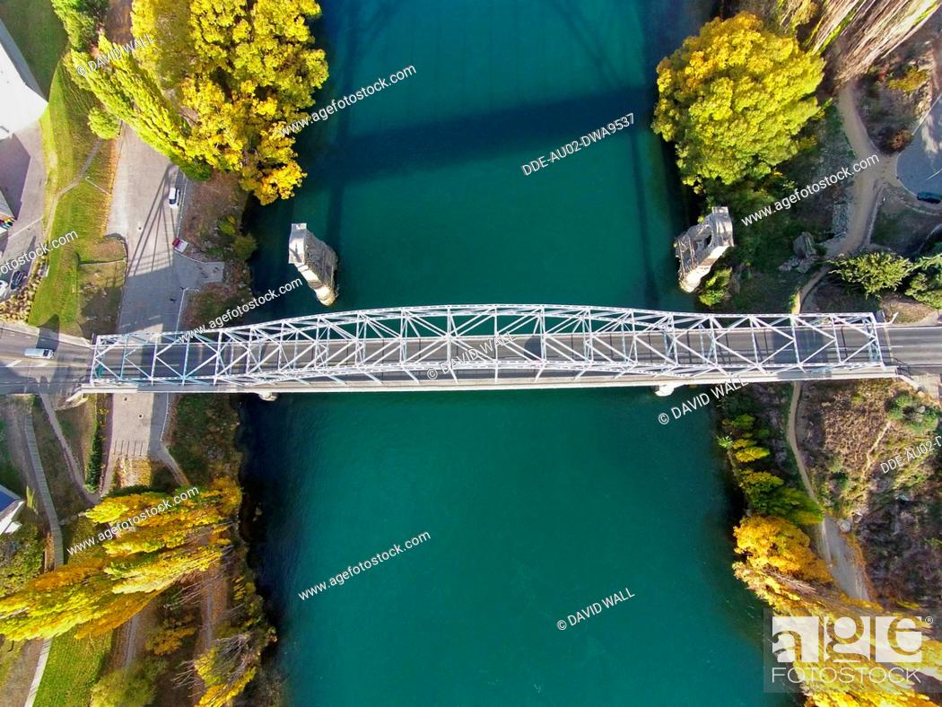 Stock Photo: Alexandra Bridge and Clutha River in autumn, Central Otago, South Island, New Zealand, drone aerial.