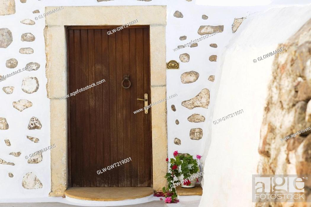 Stock Photo: Closed door of a building, Patmos, Dodecanese Islands, Greece.