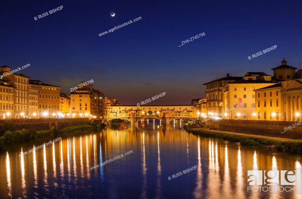Stock Photo: The Arno River and Ponte Vecchio at night, Florence, Tuscany, Italy.