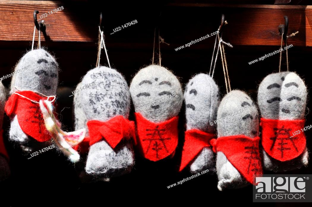 Stock Photo: Kyoto (Japan): votive dolls in a temple.