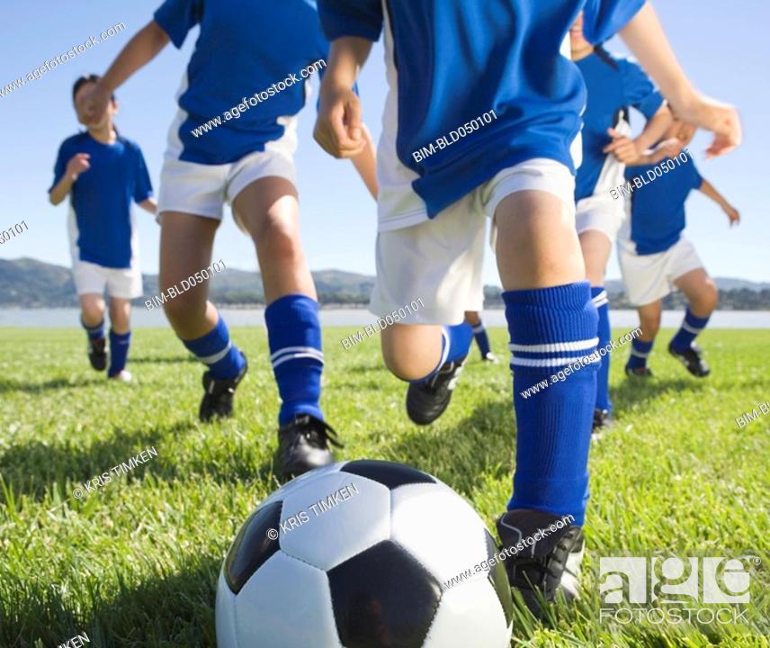 Stock Photo: Asian children playing soccer.