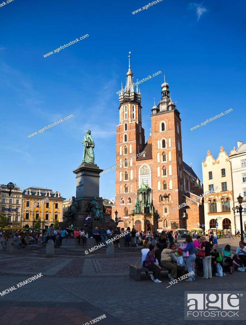 Stock Photo: Krakow landmarks - Basilica of Virgin Mary on Main Market Square and Adam Mickiewicz Monument.