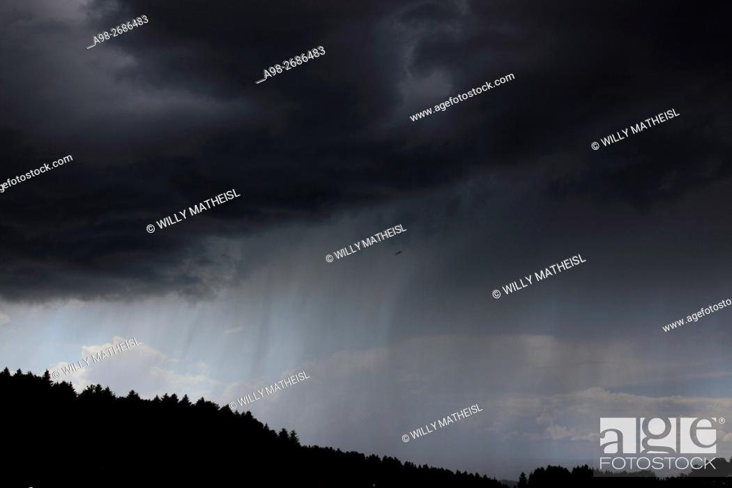 Stock Photo: descending dark wall cloud with heavy rainfall above forest, Bavaria, Germany, Europe.