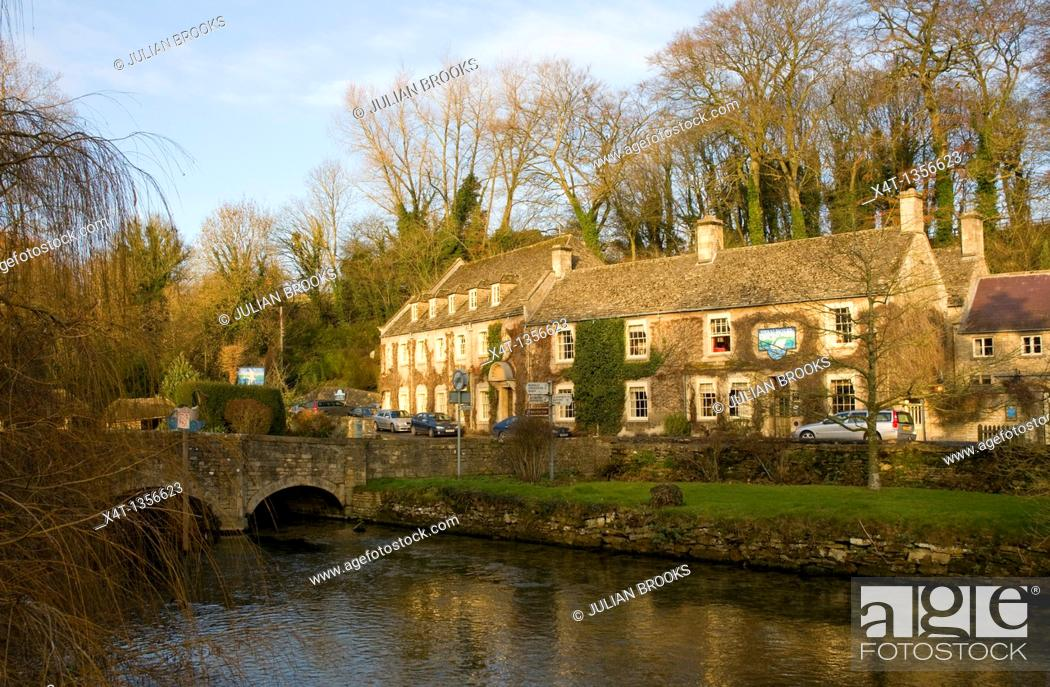 Stock Photo: The Swan Inn in Bibury, Oxforshire, winter sunshine.